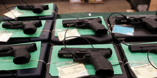FORT WORTH, TX - JULY 10:  Guns sit for sale at a gun show where thousands of different weapons are displayed for sale on Jul