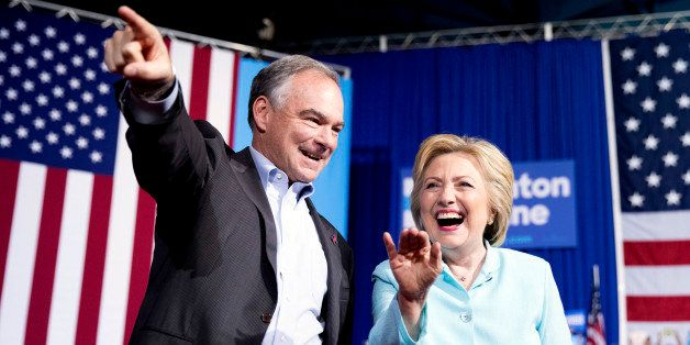 Democratic presidential candidate Hillary Clinton and Sen. Tim Kaine, D-Va., arrive at a rally at Florida International Unive
