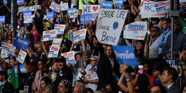 PHILADELPHIA, PA - JULY 26: Bernie Sanders supporters wave signs during the second day of the Democratic National Convention