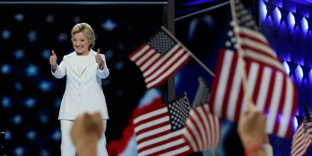 Democratic U.S. presidential nominee Hillary Clinton reacts as she arrives to accept the nomination on the fourth and final n