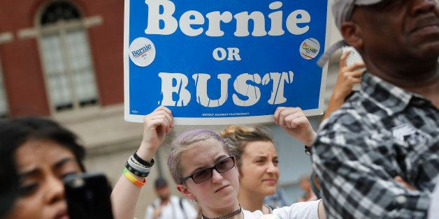 "A supporter of Sen. Bernie Sanders, I-Vt., holds a ""Bernie or BUST"" sign at a rally in Philadelphia, Thursday, July 28, 2016,"