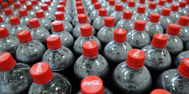 Picture taken on July 6, 2009 in Castanet-Tolosan shows Coca-Cola bottles on an assembly line at a Coca Cola bottling plant.