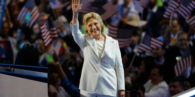 Democratic presidential nominee Hillary Clinton waves on stage at the Democratic National Convention in Philadelphia, Pennsyl