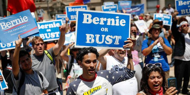 Supporters of Sen. Bernie Sanders, I-Vt., yell during a rally near City Hall in Philadelphia, Tuesday, July 26, 2016, during