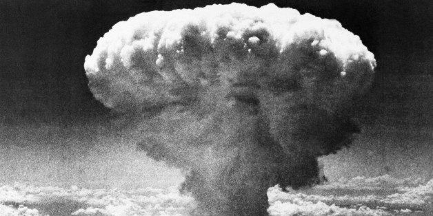 FILE - In this Aug. 9, 1945 file photo, a mushroom cloud rises moments after the atomic bomb was dropped on Nagasaki, souther