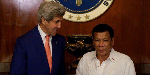 MANILA, PHILIPPINES - JULY 27 :  Philippine President Rodrigo Duterte (R) greets U.S. Secretary of State John Kerry (L) durin