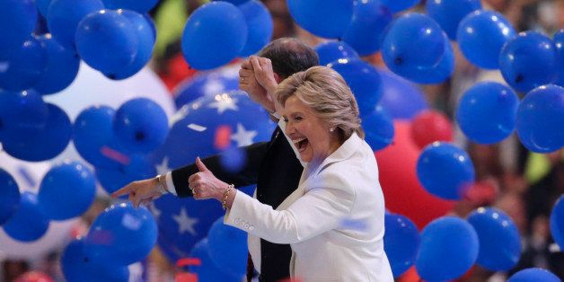 Democratic presidential nominee Hillary Clinton enjoys the balloon drop with her vice presidential running mate Senator Tim K