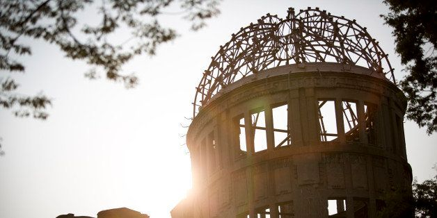 The Atomic Bomb Dome is seen at sunset in the Hiroshima Peace Memorial Park two days prior to 71st anniversary of the bombing