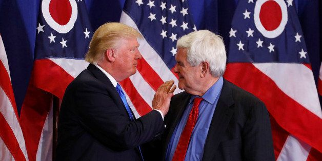 Former Speaker of the House Newt Gingrich greets U.S. Republican presidential candidate Donald Trump at a rally at the Sharon