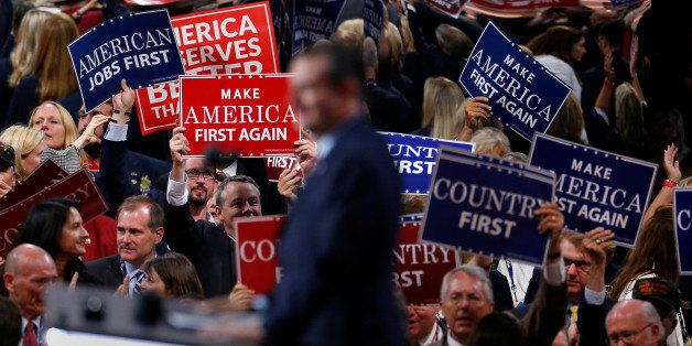 People wave placards during senator Ted Cruz's (R-TX) speech at the Republican National Convention in Cleveland, U.S., July 2