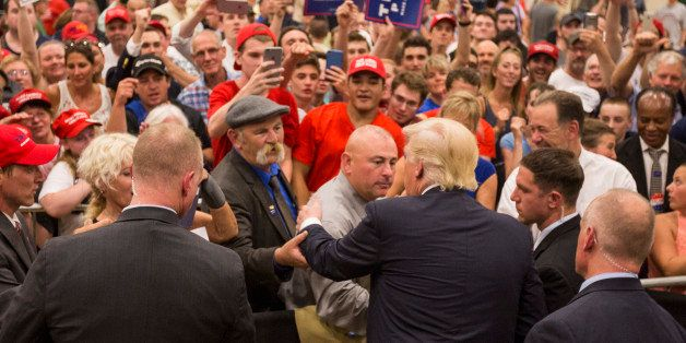 WINDHAM, NH - AUGUST 06:  Republican presidential candidate Donald Trump works the role line follwing a rally at Windham High