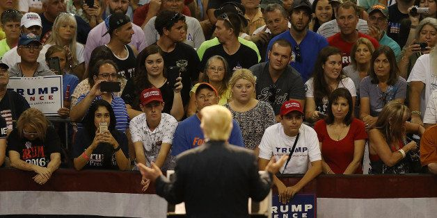 DAYTONA BEACH, FL - AUGUST 03:  People listen as Republican presidential nominee Donald Trump speaks during his campaign even