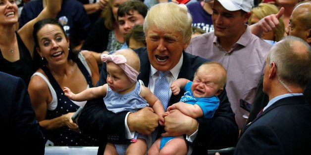 Republican presidential nominee Donald Trump holds babies at a campaign rally in Colorado Springs, Colorado, U.S., July 29, 2