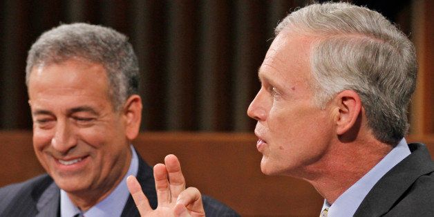 Wisconsin's Democratic candidate U.S. Senator Russ Feingold, left, listens as Republican challenger Ron Johnson, right, speak