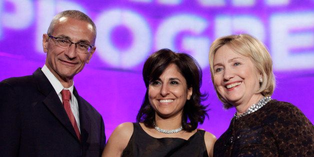 Former Secretary of State Hillary Clinton (R) poses with President of the Center for American Progress (CAP) Neera Tanden (C)