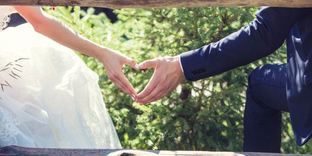 Man and woman couple holding hands on a romantic date or a wedding