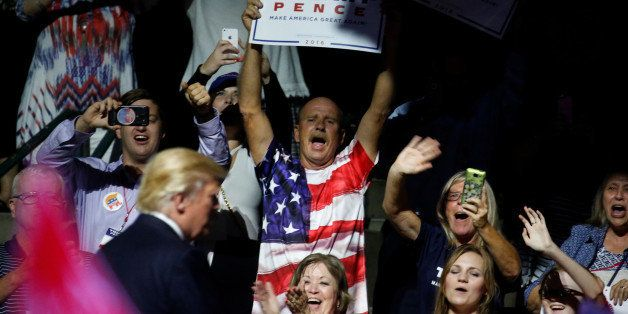 Supporters cheer as Republican presidential nominee Donald Trump takes the stage during a campaign rally in Jackson, Mississi