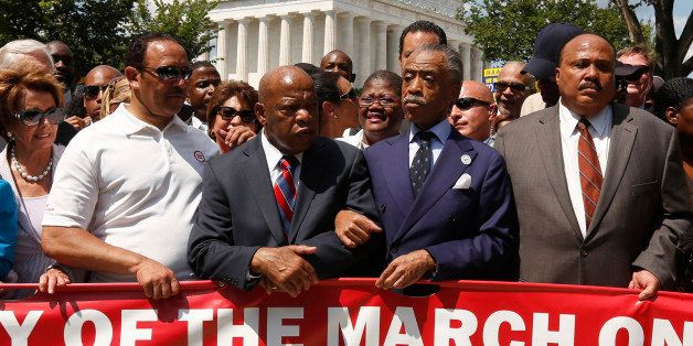 Rev. Al Sharpton (2nd R) links arms with Rep. John Lewis (D-GA) next to Martin Luther King III (R) as they begin to march dur