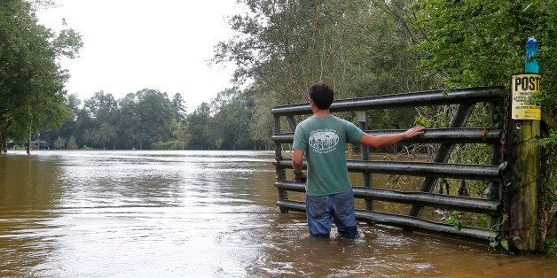 Nick George stands in the Tangipahoa River after Hurricane Isaac passed through Kentwood, Louisiana, August 30, 2012. Louisia