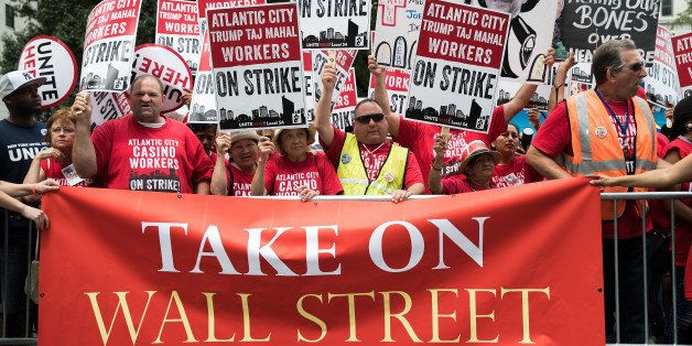 NEW YORK, NY - JULY 13: Casino workers and activists protest outside Trump Taj Mahal owner Carl Icahn's office on Fifth Avenu