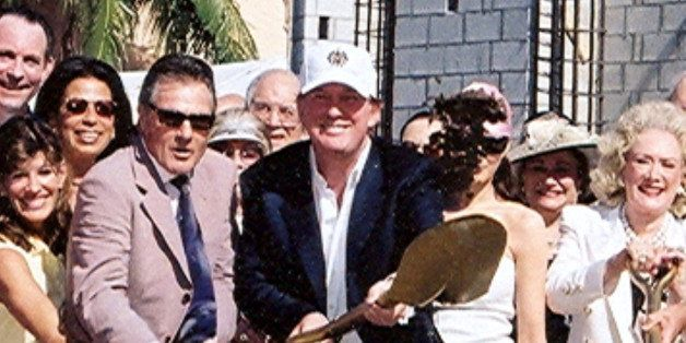 Portrait of American businessman Donald Trump, with a shovel, and unidentified others during the ground-breaking ceremony for
