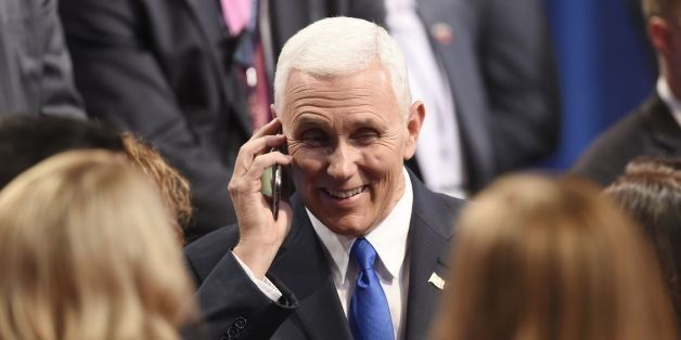 Republican vice presidential candidate Mike Pence speaks on his cell phone following the US vice presidential debate at Longw