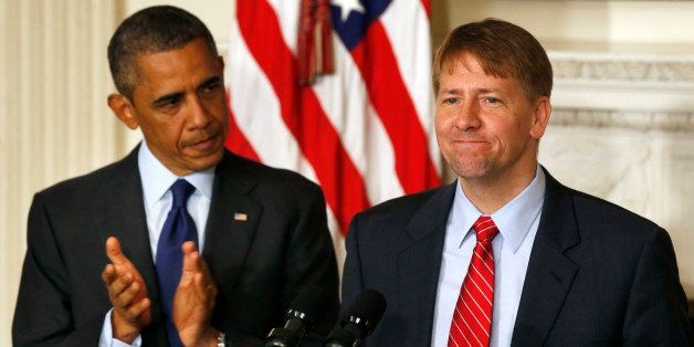 U.S. President Barack Obama (L) stands next to the new Director of the Consumer Financial Protection Bureau Richard Cordray i
