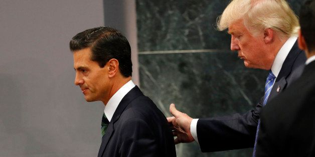Republican presidential nominee Donald Trump walks with Mexico President Enrique Pena Nieto at the end of their joint stateme