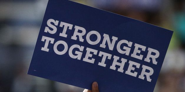 PHILADELPHIA, PA - JULY 25: A delegate holds a sign that reads 'Stronger together' on the first day of the Democratic Nationa