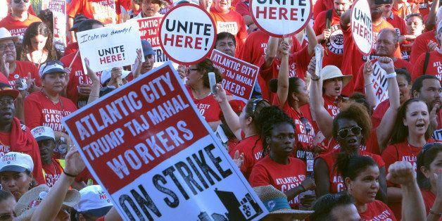 In this July 21, 2016 photo, striking union members rally outside the Trump Taj Mahal casino in Atlantic City, N.J. On Thursd