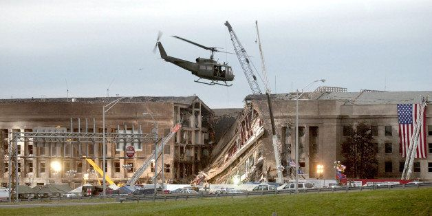 ARLINGTON, VA - SEPTEMBER 14, 2001:  (SEPTEMBER 11 RETROSPECTIVE) A military helicopter flies in front of the Pentagon Septem