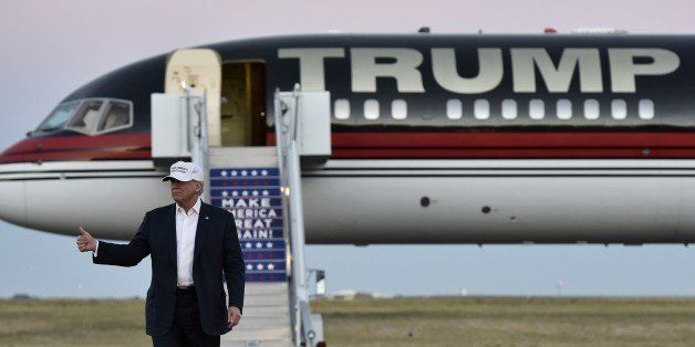 Republican presidential nominee Donald Trump walks across the tarmac as he arrives for a rally at the JetCenters of Colorado