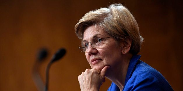 Sen. Elizabeth Warren, D-Mass., listens to Federal Reserve Chair Janet Yellen testify before the Senate Banking, Housing, Urb
