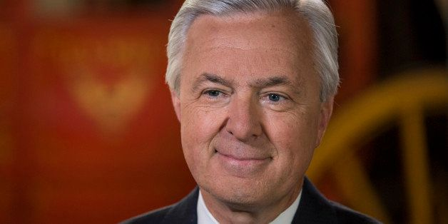 John Stumpf, chairman and chief executive officer of Wells Fargo & Co., smiles during a Bloomberg Television interview in San