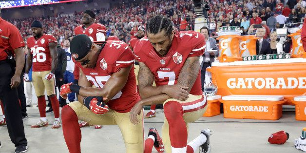 San Francisco 49ers safety Eric Reid (35) and quarterback Colin Kaepernick (7) kneel during the national anthem before an NFL
