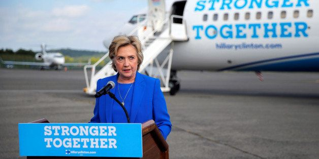 U.S. Democratic presidential candidate Hillary Clinton holds a news conference on the airport tarmac in front of her campaign