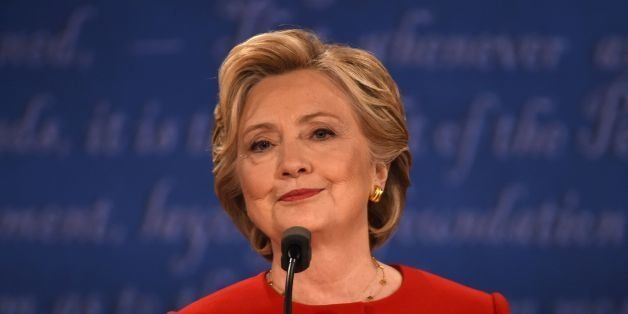 Democratic nominee Hillary Clinton smiles during the first presidential debate at Hofstra University in Hempstead, New York o