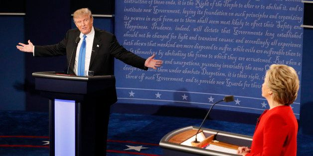 Republican U.S. presidential nominee Donald Trump speaks as Democratic U.S. presidential nominee Hillary Clinton listens duri