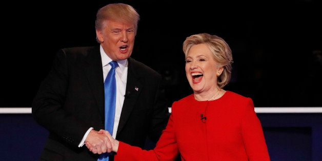 Republican U.S. presidential nominee Donald Trump shakes hands with Democratic U.S. presidential nominee Hillary Clinton at t