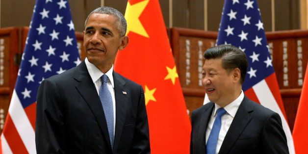 U.S. President Barack Obama and China's President Xi Jinping arrive for a bilateral meeting ahead of the G20 Summit, at West