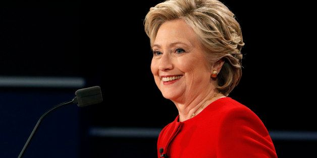 Democratic U.S. presidential nominee Hillary Clinton smiles during the first presidential debate with Republican U.S. preside