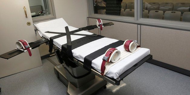 FILE - This Oct. 9, 2014, file photo shows the gurney in the the execution chamber at the Oklahoma State Penitentiary in McAl