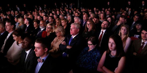 Members of the audience watch as Democratic U.S. vice presidential nominee Senator Tim Kaine and Republican U.S. vice preside