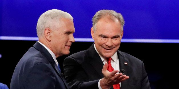 Republican vice-presidential nominee Gov. Mike Pence and Democratic vice-presidential nominee Sen. Tim Kaine walk off the sta