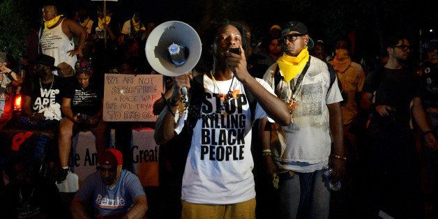 A Black Lives Matter protester addresses fellow protesters near the site of Democratic National Convention in Philadelphia, P
