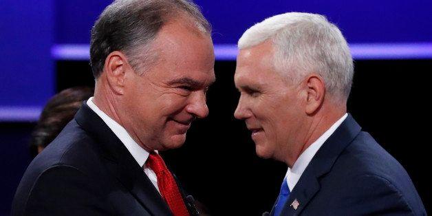 Democratic U.S. vice presidential nominee Senator Tim Kaine (L) and Republican U.S. vice presidential nominee Governor Mike P