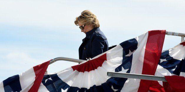 US Democrat presidential nominee Hillary Clinton arrives October 9, 2016 at Lambert-St. Louis International Airport in St. Lo