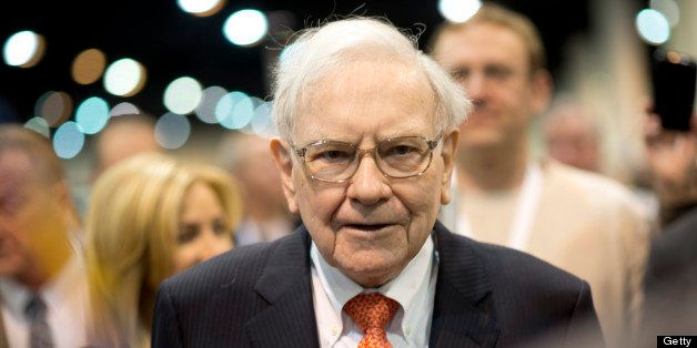 Warren Buffett, chairman and chief executive officer of Berkshire Hathaway Inc., tours the exhibition floor prior to the star