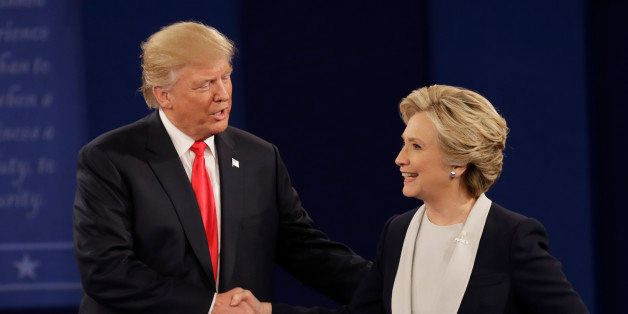 Republican presidential nominee Donald Trump shakes hands with Democratic presidential nominee Hillary Clinton following the