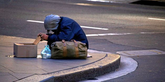 A man claiming to be homeless begs for money on a street corner in central Sydney, Australia July 2, 2016. Picture taken July